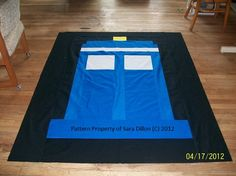 My TARDIS quilt. Pattern by me. I broke the box down into managable quilt peices and worked 2 1/2 hours on working up a pattern. This is just a mock up so te fabric is cheap and I'm not 100% on the blue color but I am really happy with how it came together. If only I could sell them and the pattern. Stupid copywrite laws.