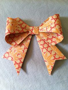 Origami ribbon bow I learned how to make when I was wrapping Christmas presents and realized I was out of bows.  All I needed was some paper and this blog: http://pdxpursuit.wordpress.com/2011/02/28/origami-bow/