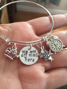 "Alice in wonderland Bracelet with rabbit clock  tea kettle and cup and hand stamped ""we are all mad here"" charms"