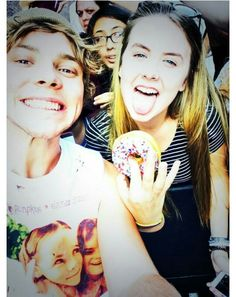 Ash with a fan. Lol the girl on his shirt looks like she's looking at the donut.