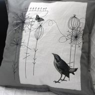 Hand and machine embroidered cushion in grey and cream  with printed and appliquéd bird and butterfly. This unique item is made of a soft, heavyweight cotton, the back is plain grey with an envelope style opening. It has a polyester, non allergic inne...