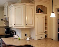 Annandale Kitchen   Upper Cabinets Wrap Around A Corner With Alternating  Top Heights And Beefy Crowns