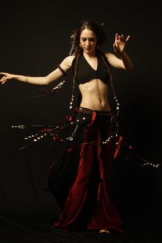 Wild Spin - Top, Overskirt, Upper Arm Band, Belt -Onyx Hardware. Photo- Phillip Woong, '06.