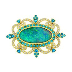 This beautiful pendant is crafted in 18 kt yellow gold and is graced with opal, diamond and apatite. #opalsaustralia