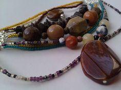 Amber chunky 9 strand chandelier necklace. $45.00, via Etsy.