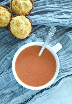 Easy Keto Tomato Basil Soup in a white bowl with spoon