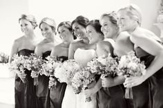 An August bride with her best girlfriends as her bridesmaids