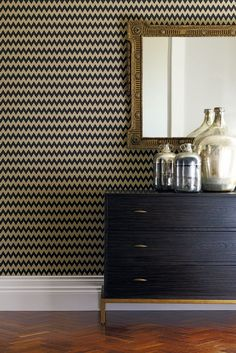 An all over, zig zag pattern inspired by Kilims, on a textural background. Chevron wallpaper