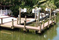 Manilla rope railing surrounding a dock