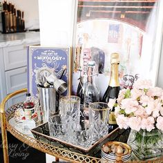 Krista @lipstickandpaintchips tagged me to share for #barcartbeautiful last week and I finally get the chance to post it now! Hosts tagged on right. This #barcart was a bargain from @jossandmain. I love its antiqued mirror tops and it's the perfect size for this odd #diningroom wall. Hmm... Wonder if the Mr. is in the mood to share some #Proseco with me tonight? Or I can always enjoy my glass of chocolate #martini... mmm 😋 . Thanks Qui @house_of_quiana and Ana @aglimpse_of_mylife_ for t...