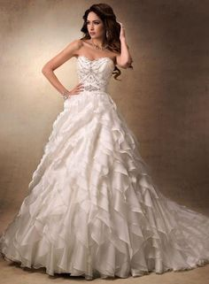 "Maggie Sottero ""Fallon"" 19413 ""Fallon"" strapless organza ball gown wedding dress with a sweetheart neckline, beaded bodice, and ruffle skirt. Size 8, Ivory, Regular Price $1798, Sale Price $1260. In Stock, Ships Immediately."