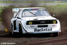 Swedish fourfold European Rallycross Champion Olle Arnesson hurling his Audi Sport quattro over Sweden's Kinnekulle Ring in © - New Sites Sport Quattro, Audi Quattro, Off Road Racing, Audi Sport, Four Wheel Drive, Rally Car, Car And Driver, Wrx, Driving Test