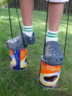 Ready for school to be out and get outdoors? Use items you have at home for some old school fun! These coffee can stilts will keep kids entertained for hours! #teachmama #kidsactivities #summer #summeractivities #outdoors #outdooractivities #boredombusters #oldschool #games