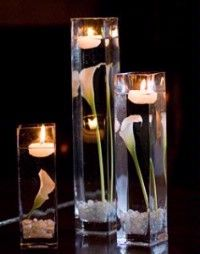 calla lily centerpiece with candles. use purple calla lillies Winter Wedding Centerpieces, Wedding Table, Wedding Decorations, Quinceanera Centerpieces, Graduation Centerpiece, Decor Wedding, Calla Lillies Centerpieces, Calla Lilies, Submerged Flowers