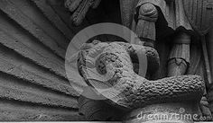 Shot in black and white, detail on an sculpture representing a dragon standing at the feet of St George placed on the facade of this historic church, set in Gothic district, Barcelona, Catalonia, Catalunya, España, Spain, Europe, Europa