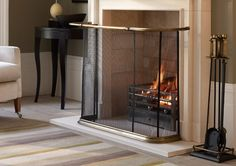 A curved black mesh fire screen with patinated antique brass elements is available with or without a brass rail enabling the screen to be easily lifted and moved. Old School House, Log Fires, Fireplace Screens, Entrance Hall, New Homes, Architecture, Fireplaces, Modern, Antique Brass