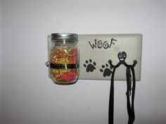 """Personalized Dog Leash & Treat Holder, Key Holder  *Driftwood stain was applied over a white undercoat  *Comes in a variety of colors  *11"""" x 5 1/2"""" x 1""""  *A wide mouth pint size mason jar to hold the """"goodies"""" is held on with a hose clamp  *Personalized name  *Double metal hooks to hold a leash or two and or a set of keys  *Two saw tooth hangers on back for easy hanging  All of our items are handmade in our small ..."""