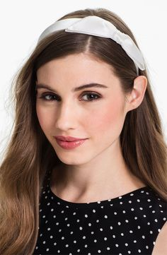 This simple white bow headband is the perfect accessory to create a chic modern bridal look.