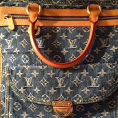 """LV Blue Jean Bag. This bag is in great condition, two small pen marks inside, lots of pockets, this is not a shoulder bag, size W 12"""" H 14"""". Please use offer feature, no trades or PP. please note no negations under comments, if you are interested make me a reasonable offer and we will go from there. Thank you! Louis Vuitton Bags"""