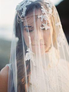 Nothing says romantic like a wedding veil.  http://www.weddingchicks.com/2014/04/17/beach-bridal-session-tips/