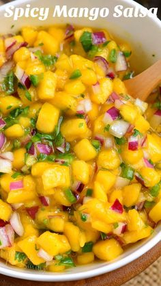 Mango Salsa recipe is an amazing treat that combines juicy sweet mangoes spicy jalapeno peppers red onion lime juice a little honey cayenne and cilantro. This tropical salsa is a staple in summer cooking. Mango Ceviche Recipe, Mango Salsa Recipes, Jalapeno Recipes, Mango Salad, Honey Recipes, Tropical Salsa Recipe, Spicy Recipes, Mexican Food Recipes, Vegetarian Recipes