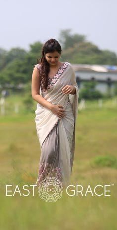 Featuring a misty gray pure georgette saree from EAST & GRACE with beautiful neon pink Frangipani flowers embroidered on the trims and along the pleats of the saree. Pleats are flow-dyed in deeper gray. Send us a message via www.facebook.com/eastandgrace. Visit www.eastandgrace.com. Saree on Sale! Price: RS.9,000.