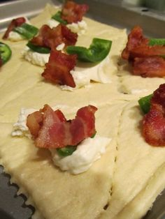 Ingredients: 1 tube crescent rolls ½ block (8 Oz. Size) Cr. Cheese 1 Med Jalapeno, Sliced Into Rounds 8 slices Cooked Bacon ½ cups Ranch Dressing, For Dipping Directions: Open crescent rolls, break into precut triangles. Cut each in half = 2 smaller triangles. 1 teaspoon cr cheese on each triangle. 1 jalapeno pepper slice on cr cheese. Place 1/3 slice bacon, folded on jalapeno. Wrap crescent roll around all, press edges to seal. Bake according to roll instructions until lightly browned.