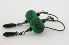 I love these handmade black lace on dark green artisan made beads. Black lace over a gorgeous green and etched for a soft finish. I framed them with Swarovski crystals for a bit of sparkle - SOLD