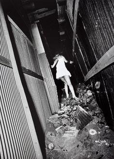 """Daido Moriyama  """"Untitled (woman in white dress running),"""" 1971, gelatin silver print"""