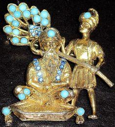 Hattie Carnegie maharaja fanned by slave turquoise rhinestone pin