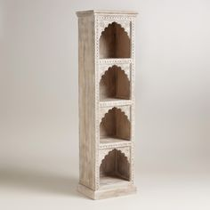 Woodwork has been prevalent in Rajasthan, India since the 1600s and is seen in palaces and havelis, private mansions, throughout the region. This found bookshelf was handcrafted using a detailed and laborious process. The design was drawn on paper, transferred onto wood using ink and then carved using various chisels. Finally, it was buffed to bring out the wood's shine. This piece makes a welcoming home for collectibles and treasured books.