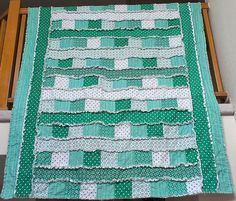 "Patchwork & Strip #ragquilt - 60"" x 120"" - 100 #charmsquares and 7 #fatquarters for front, 4 yards flannel for batting, 4 yards backing fabric. 1/2 inch rag seams; 8 strips hidden over edge"