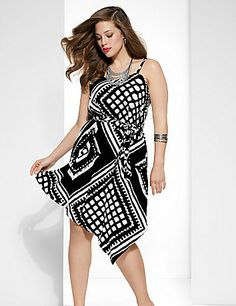 Dare to be the one that turns heads in our gorgeous dress with an asymmetric hem. This dramatic dress makes a bold statement in eye-catching black & white tribal print - the must-try trend of the season! Designed to wow every curve, this silky number features a V-neck, adjustable straps and a self-tie belt. Pair with a statement necklace and killer heels and prepare for compliments. lanebryant.com