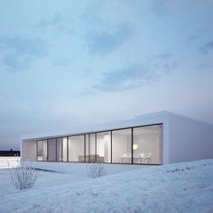 Located in Reykjavik, Iceland, this minimalist house with large windows was designed by MOOMOO Architects.