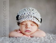 Baby Boy in a little hat! I must have a picture of my little guy like this.