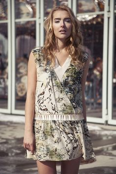 Cindy + Johnny drop waisted printed silk dress with gold spike chain detail around leather waistband.