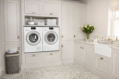 When creating your laundry room, it helps to consider those who will use it the most, and the longevity of the space. When washing machines and tumble dryers are installed at eye level, as seen here, it helps to reduce the frequent bending required to load and unload the machines