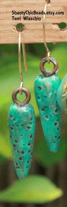 Funky Turquoise drop beads.  By Terri Wlaschin.  Can be found at:  https://www.etsy.com/listing/217769783/poly-clay-rustic-turquoise-drop-beads?ref=shop_home_active_8