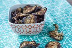 Eggplant chips are baked with spices for a healthier, satisfying snack. Get the recipe.