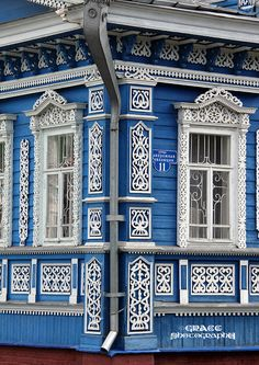 traditional decorative carved wood window frames + trim, gorodets, russia | architectural details