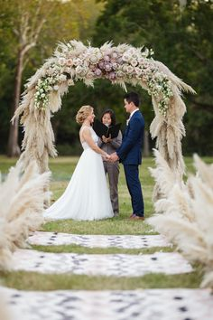 Boho Lux Wedding Featured on @MarthaWeddings | Photography by @kobybrownphoto | Outdoor  Wedding | Pampas Grass Aisle