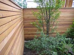 Love the horizontal wood for a more modern, different fence.