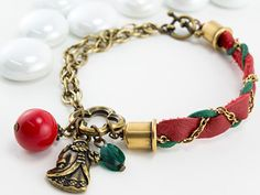 Père Noël Bracelet featuring TierraCast Leather Strap, 6mm Cupola Cord Ends, St. Nick Charm and Med Quatrefoil Link. Design by Tracy Gonzales for TierraCast