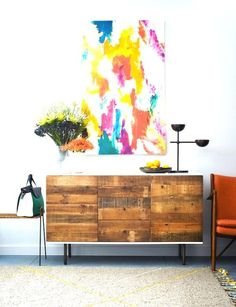 Bold artwork in bright colours at home above the hutch in the dining room.