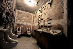 """At """"Punk: Chaos to Couture,"""" the new fashion exhibition at the Metropolitan Museum of Art, visitors are immediately confronted with a re-creation of a filthy restroom of CBGB."""