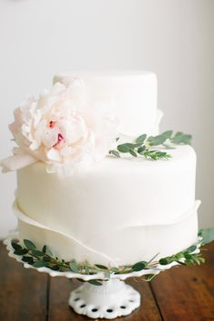 A flower topped white cake is timeless and effortlessly chic: http://www.stylemepretty.com/2015/08/25/classic-wedding-details-that-stand-the-test-of-time/