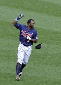 Denard Span #2 of the Minnesota Twins celebrates hitting a walk off single against the Milwaukee Brewers in the fifteenth inning on June 17, 2012 at Target Field in Minneapolis, Minnesota. The Twins defeated the Brewers 5-4 in fifteenth innings.