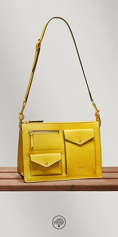 The Cherwell draws on the collection's theme of utility with its rectangular box shape and array of pockets overlaying the bag's surface. Shop the Cherwell Satchel in Lemon Leather at Mulberry.com.