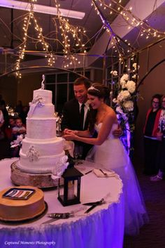 Calli and Anthony cutting the cake on October 2013 at Sunset Zoo! photo courtesy of Captured Moments Photography. Anthony Cuts, Zoo Photos, October 5th, Unique Settings, Outdoor Venues, Big Day, Perfect Wedding, Manhattan, Real Weddings