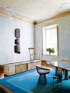 """It was two years ago when architect and sculptor Vincenzo de Cotiis and his wife, Claudia, discovered their 18th-century palazzo apartment in the old neighbourhood of Magenta. """"We'd previously lived in Brera, a very central, busy district,"""" he explains. """"I'd always hoped to live in this area, but the right spaces are very hard to find. I wanted somewhere that retained original features, but still needed a lot of work. We were lucky. It was love at first sight wh..."""